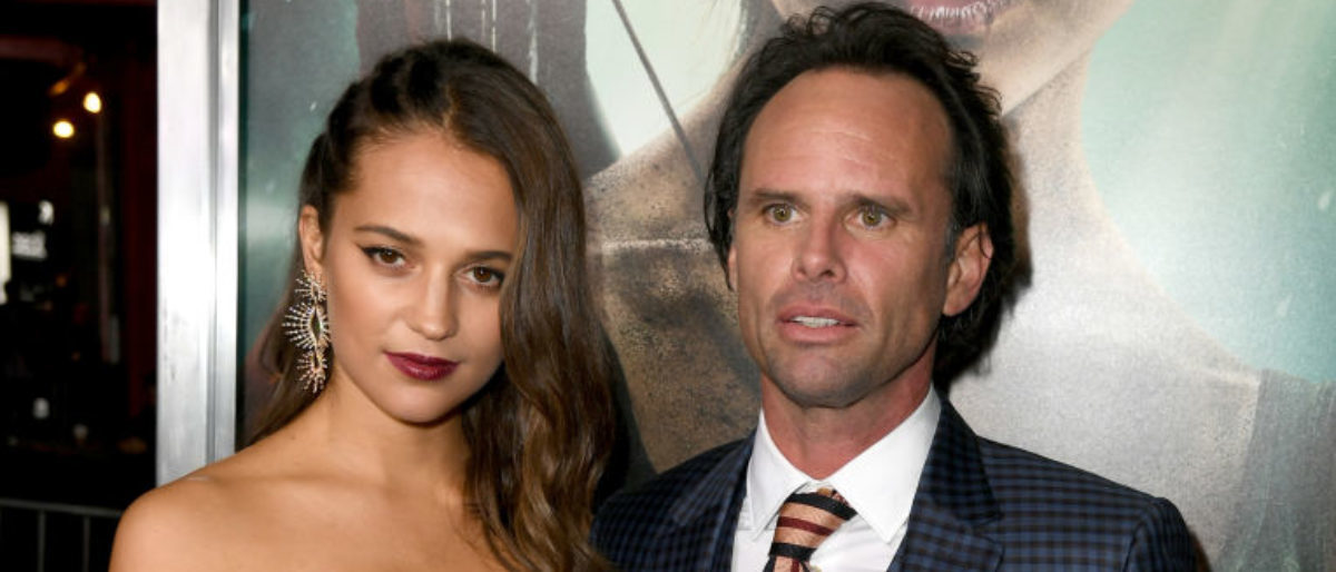 """HOLLYWOOD, CA - MARCH 12:  Alicia Vikander(L) and Walton Goggins attend the premiere of Warner Bros. Pictures' """"Tomb Raider"""" at TCL Chinese Theatre on March 12, 2018 in Hollywood, California.  (Photo by Kevin Winter/Getty Images)"""