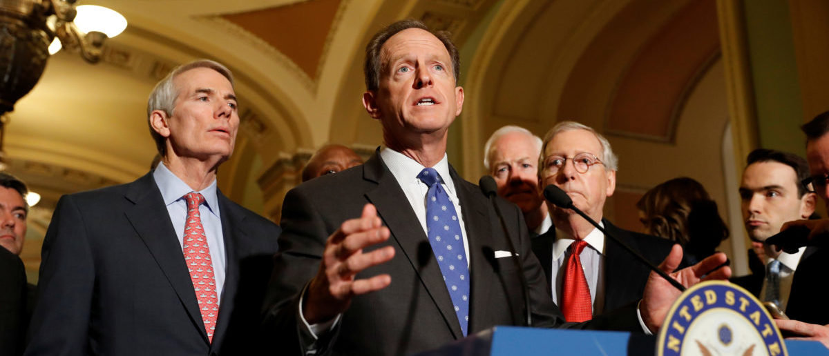 Sen. Pat Toomey (R-PA), accompanied by Sen. Rob Portman (R-OH) and Senate Majority Leader Mitch McConnell, speaks with reporters following the party luncheons on Capitol Hill in Washington, U.S. November 14, 2017. REUTERS/Aaron P. Bernstein