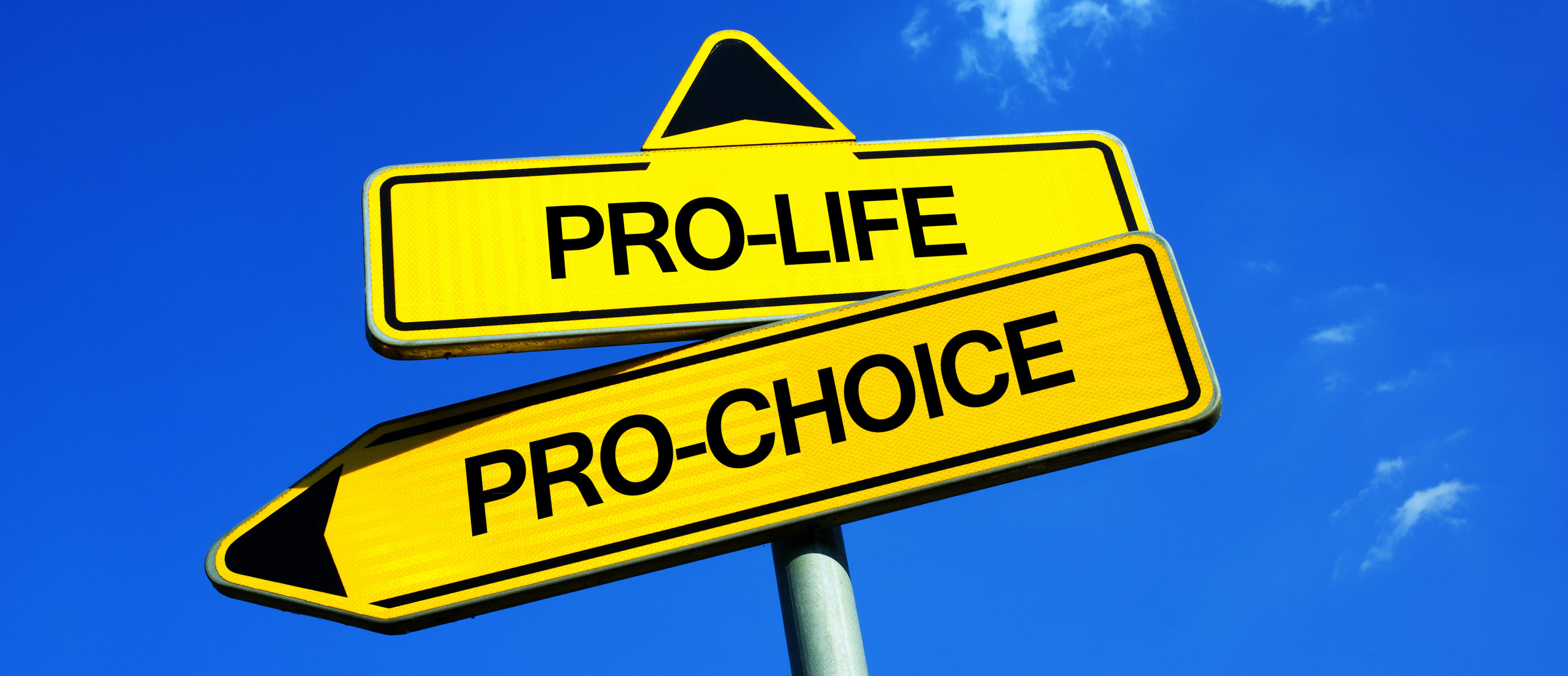Traffic sign with two options (Shutterstock/M-SUR) | Catholic OB-GYN Explains Why She Aborted