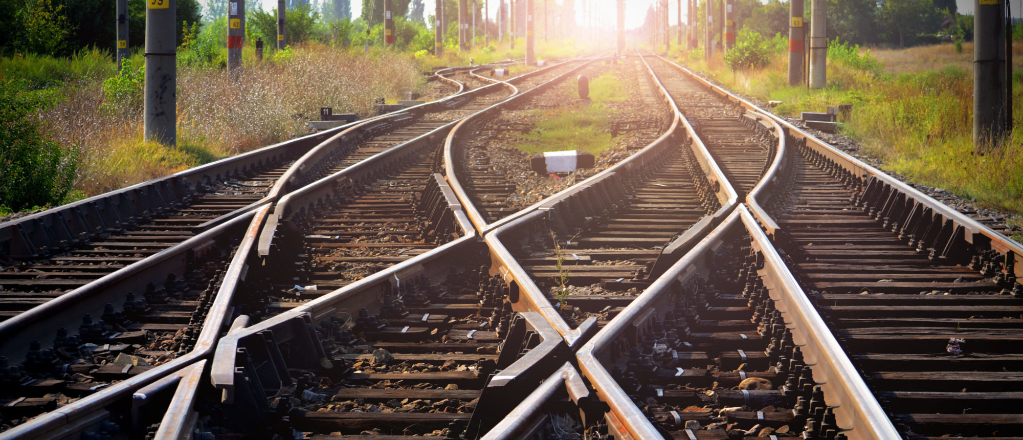 Train tracks leading into the sunset. (Shutterstock)