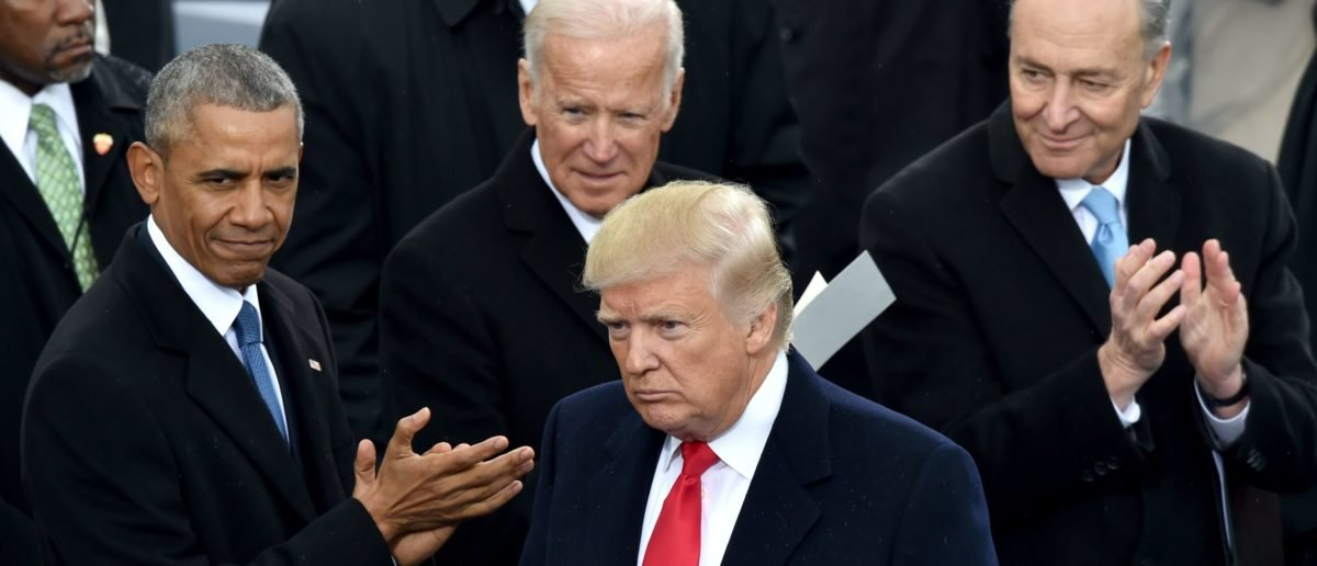 President Trump is applauded by former President Obama, former Vice President Biden, and Sen. Schumer. Paul J. Richards/AFP/Getty Images.