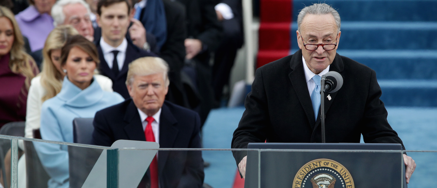 President-Elect Donald Trump listens as Sen. Charles Schumer (D-NY) speaks on the West Front of the U.S. Capitol on January 20, 2017 in Washington, DC. In today's inauguration ceremony Donald J. Trump becomes the 45th president of the United States. (Photo: Alex Wong/Getty Images)