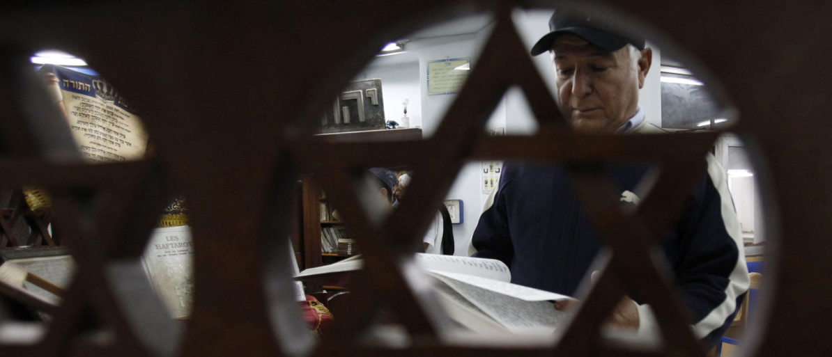 A Tunisian Jew reads from the Torah in a synagogue in Tunis October 26, 2011. REUTERS/Zoubeir Souissi