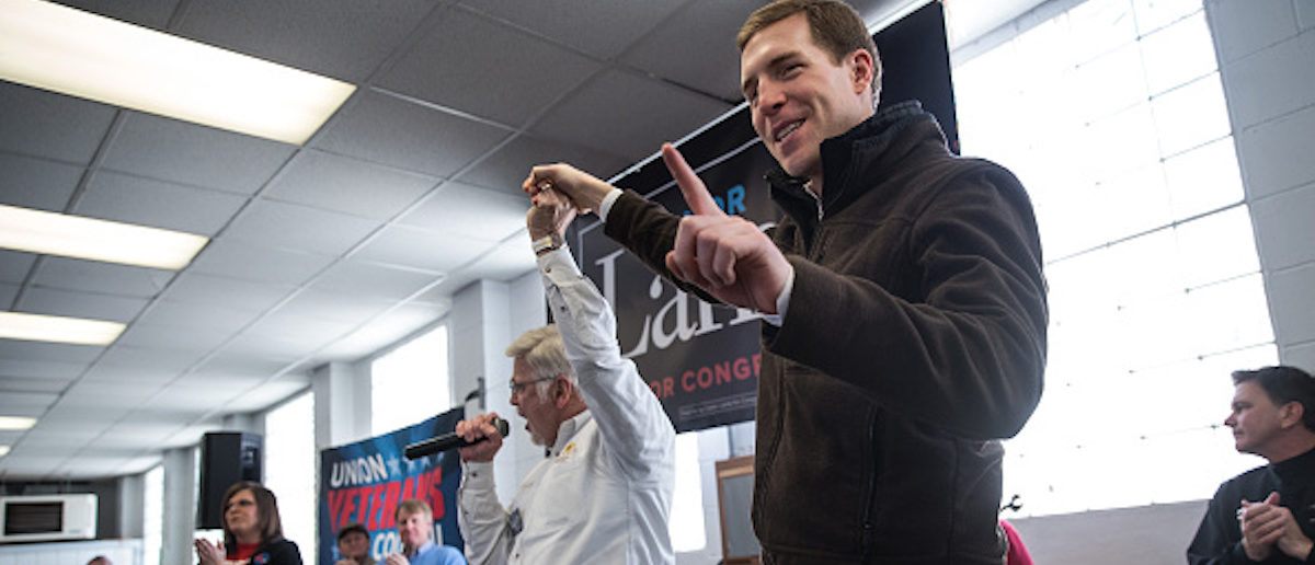 WAYNESBURG, PA - MARCH 11: UMWA President Cecil Roberts (L) and Conor Lamb, Democratic Congressional candidate for Pennsylvania's 18th district, gesture at a campaign rally with United Mine Workers of America (UMWA) at the Greene County Fairgrounds, March 11, 2018 in Waynesburg, Pennsylvania. Lamb is running in a tight race for the vacated seat of Congressman Tim Murphy against Republican candidate Rick Saccone. (Photo by Drew Angerer/Getty Images)