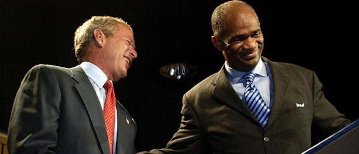 U.S. President George W. Bush (L) is greeted by Pastor Kirbyjon Caldwell (R), the founder of the Pyramid Community Development Corporation, at the Power Center 12 September 2003 in Houston, Texas.(Photo: STEPHEN JAFFE/AFP/Getty Images)