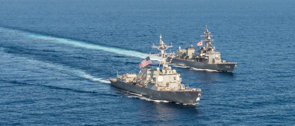 Arleigh Burke-class guided-missile destroyer USS Mustin (DDG 89) transits in formation with Japan Maritime Self-Defense Force ship JS Kirisame (DD 104) during bilateral training in South China Sea on April 21, 2015. Courtesy David Flewellyn/U.S. Navy/Handout via REUTERS | US Warships Challenge China's Sea Claims