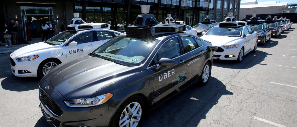 FILE PHOTO: A fleet of Uber's Ford Fusion self driving cars are shown during a demonstration of self-driving automotive technology in Pittsburgh, Pennsylvania, U.S., September 13, 2016. REUTERS/Aaron Josefczyk/File Photo