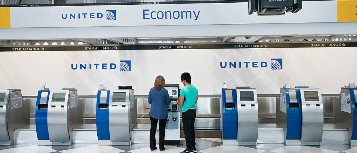 CHICAGO, IL - JUNE 02: Passengers check-in for flights with United Airlines at O'Hare Airport on June 2, 2015 in Chicago, Illinois. United travelers experienced widespread delays this morning after the airline was forced to ground flights after experiencing computer problems. The issue coincided with reports of bomb threats being made against several airlines, including a United. (Photo by Scott Olson/Getty Images)