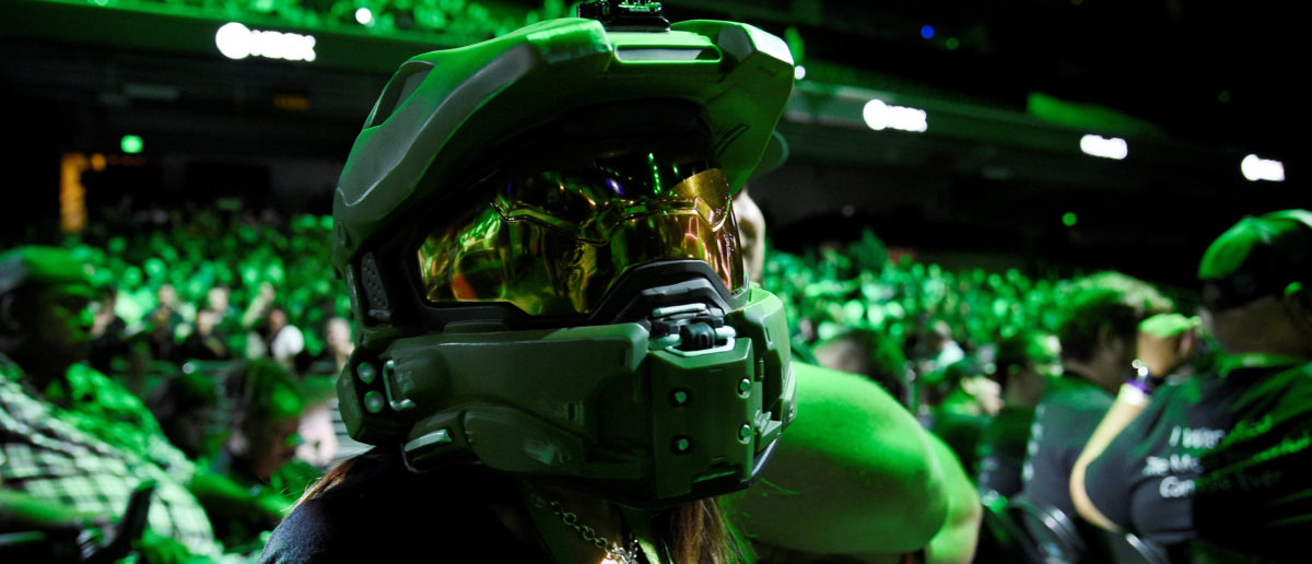 An attendee wearing a Halo Master Chief helmet waits for the Microsoft Xbox E3 2017 media briefing in Los Angeles, California, U.S., June 11, 2017. REUTERS/Kevork Djansezian