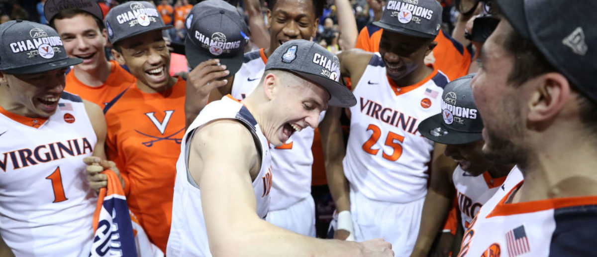 NEW YORK, NY - MARCH 10:  Tournament MVP Kyle Guy #5 of the Virginia Cavaliers celebrates with teammates after defeating the North Carolina Tar Heels 71-63 during the championship game of the 2018 ACC Men's Basketball Tournament at Barclays Center on March 10, 2018 in the Brooklyn borough of New York City.  (Photo by Abbie Parr/Getty Images)