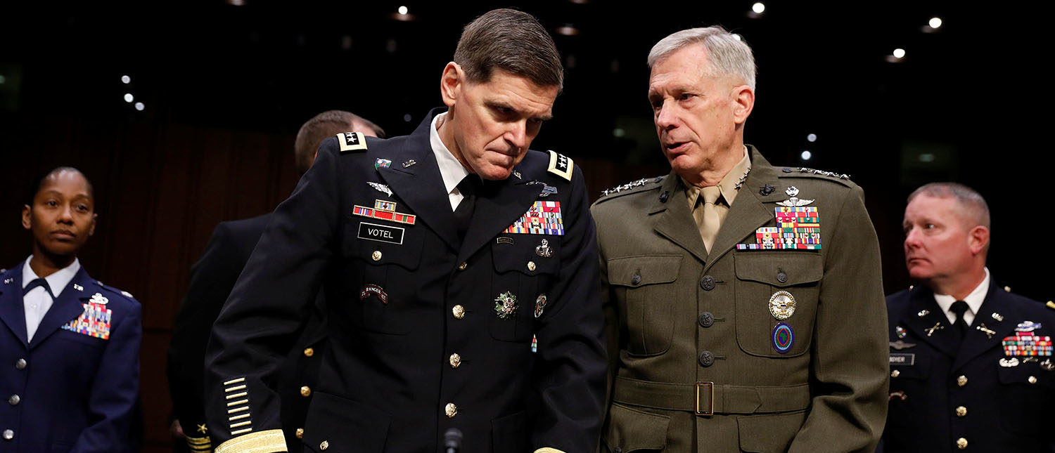 U.S. Army General Joseph Votel, commander of the U.S. Central Command, speaks with U.S. Marine Corps General Thomas Waldhauser, the commander of U.S. Africa Command, at right, as they arrive to testify before the Senate Armed Services Committee on Capitol Hill in Washington, March 13, 2018. REUTERS/Aaron P. Bernstein