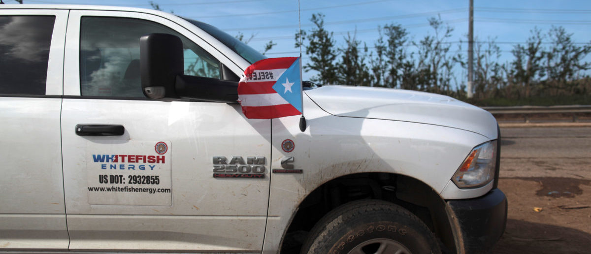 A pick up from Montana-based Whitefish Energy Holdings is parked as workers (not pictured) help fix the island's power grid, damaged during Hurricane Maria in September, in Manati, Puerto Rico October 25, 2017. REUTERS/Alvin Baez | Puerto Rico Still Hasn't Paid Whitefish
