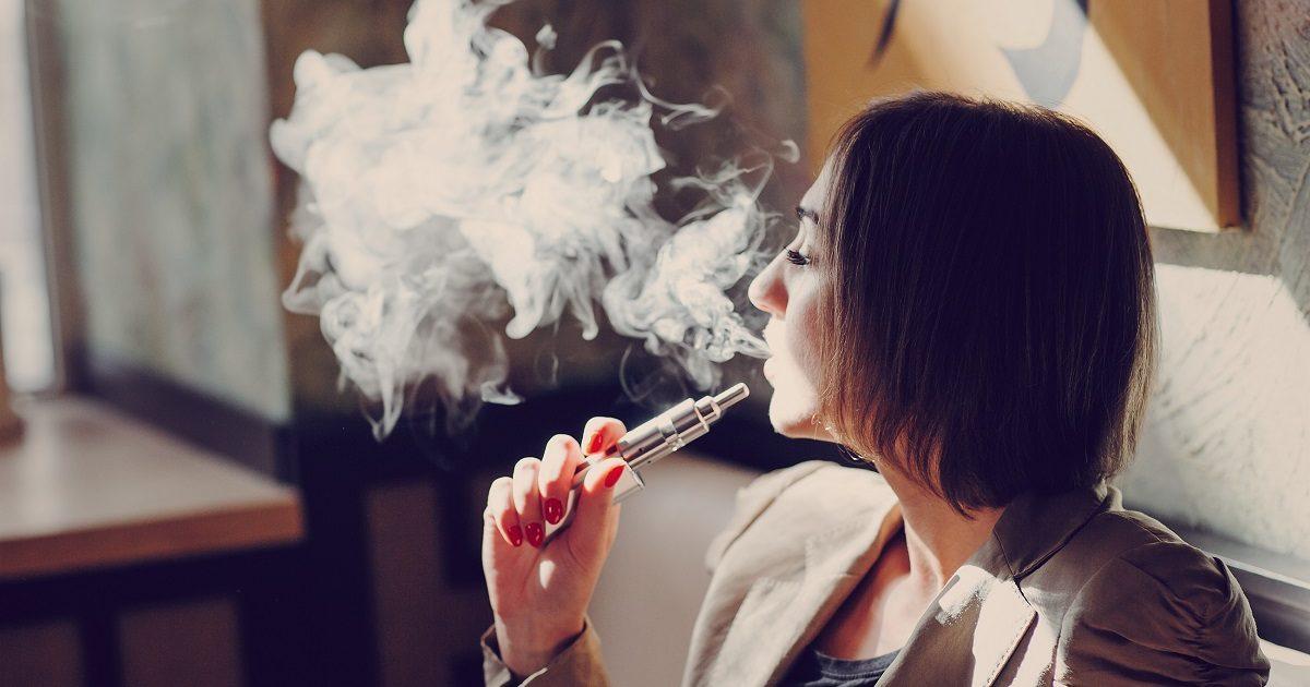 Bill Ripped Treating E-Cigs Like Smoking | young woman smoking electronic cigarette. (Oleggg/Shutterstock)