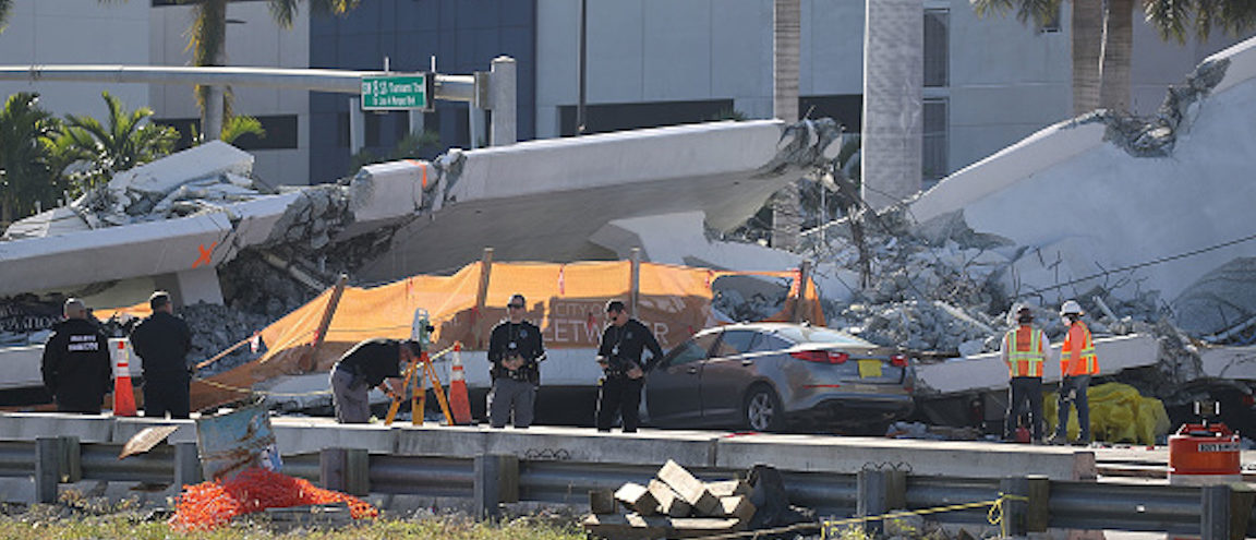 MIAMI, FL - MARCH 16: Workers, law enforcement and members of the National Transportation Safety Board investigate the scene where a pedestrian bridge collapsed a few days after it was built over southwest 8th street allowing people to bypass the busy street to reach Florida International University on March 16, 2018 in Miami, Florida. Reports indicate that there are six fatalities as a result of the collapse. (Photo by Joe Raedle/Getty Images)