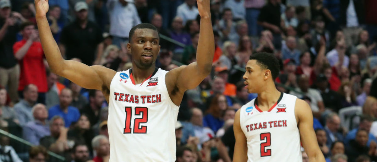 DALLAS, TX - MARCH 15: Keenan Evans #12 of the Texas Tech Red Raiders celebrate alongside teammate Zhaire Smith #2 in the second half against the Stephen F. Austin Lumberjacks in the first round of the 2018 NCAA Men's Basketball Tournament at American Airlines Center on March 15, 2018 in Dallas, Texas. The Texas Tech Red Raiders won 70-60. (Photo by Tom Pennington/Getty Images)