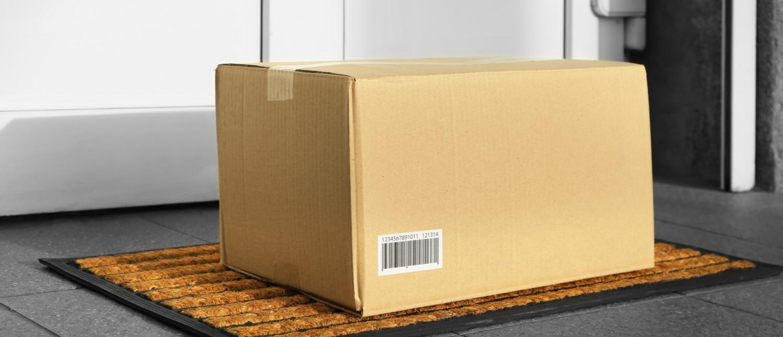 Cardboard box on a doorstep (Photo: Shutterstock/Africa Studio)