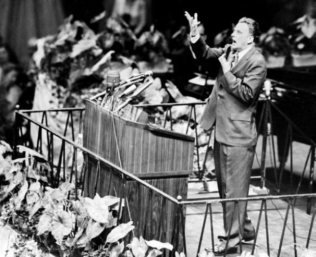 NEW YORK, UNITED STATES: Billy Graham, the American evangelist, preaches 20 May 1957 in Madison Square Garden in New York. Graham, (son of a dairy farmer, born in 1918 in Charlotte, NC), attended Florida Bible Institute and was ordained a Southern Baptist minister in 1939 and quickly gained a reputation as a preacher. During the 1950s he conducted a series of highly organized revivalist campaigns in the USA and UK, and later in South America, the USSR and Western Europe. (AFP/AFP/Getty Images)