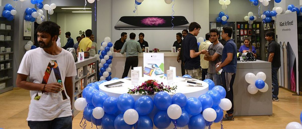 Indian customers wait to buy the new Apple iPhone 6 at the Unicorn Infosolutions Apple Premium Reseller store in Ahmedabad early on October 17, 2014. Apple launched the iPhone 6 and iPhone 6 Plus smartphones in India at midnight on October 17. AFP PHOTO / Sam PANTHAKY (Photo credit should read SAM PANTHAKY/AFP/Getty Images)