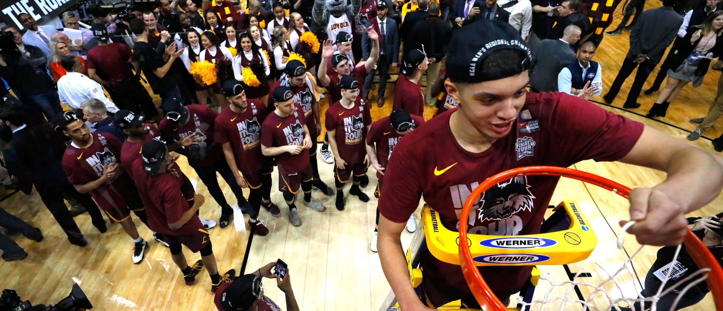 Lucas Williamson #1 of the Loyola Ramblers celebrates by cutting down the net after defeating the Kansas State Wildcats during the 2018 NCAA Men's Basketball Tournament South Regional at Philips Arena on March 24, 2018 in Atlanta. Loyola defeated Kansas State 78-62 to advance to the Final Four. (Photo by Ronald Martinez/Getty Images)