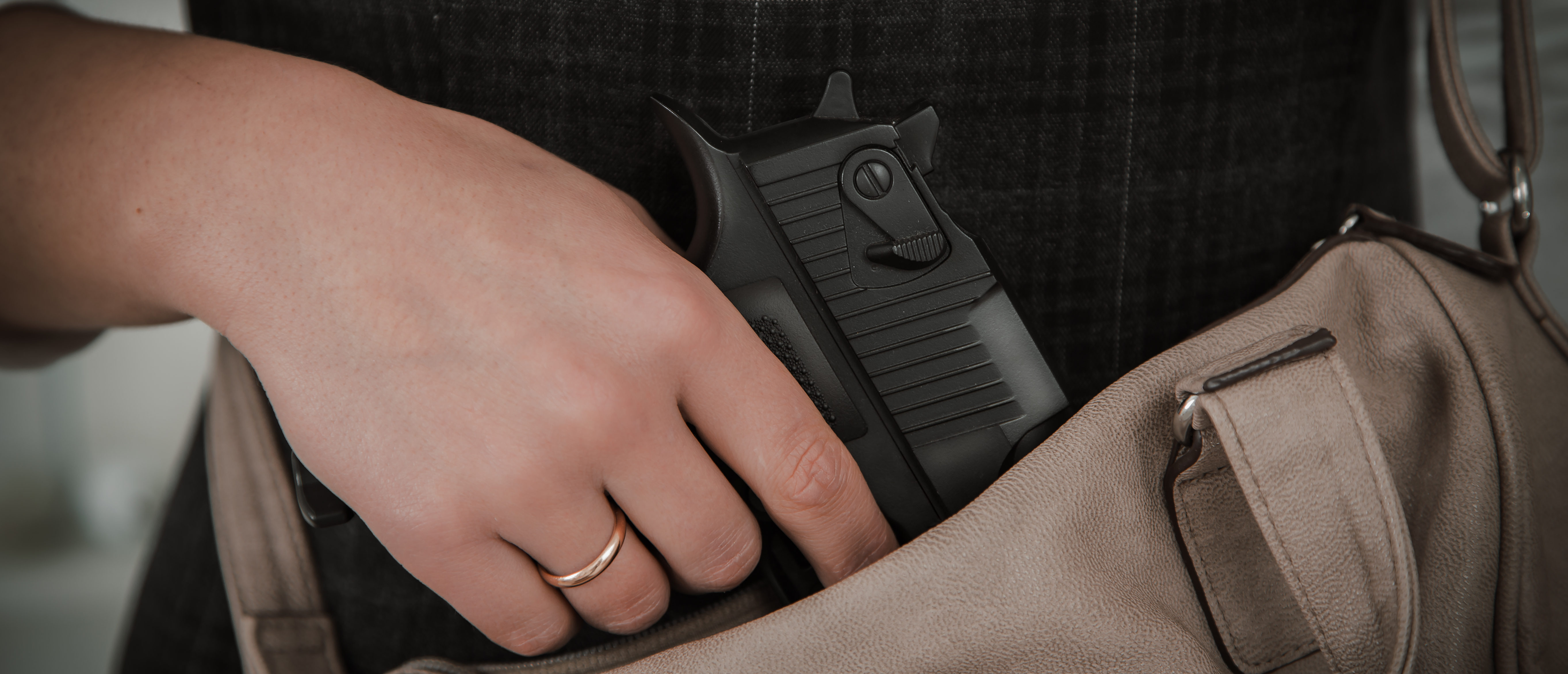 Woman with concealed carry (shutterstock