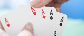 Four aces poker hand (Shutterstock)