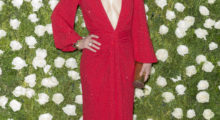 Wilde rocks the red carpet sporting a plunging red dress. (Photo: Shutterstock)