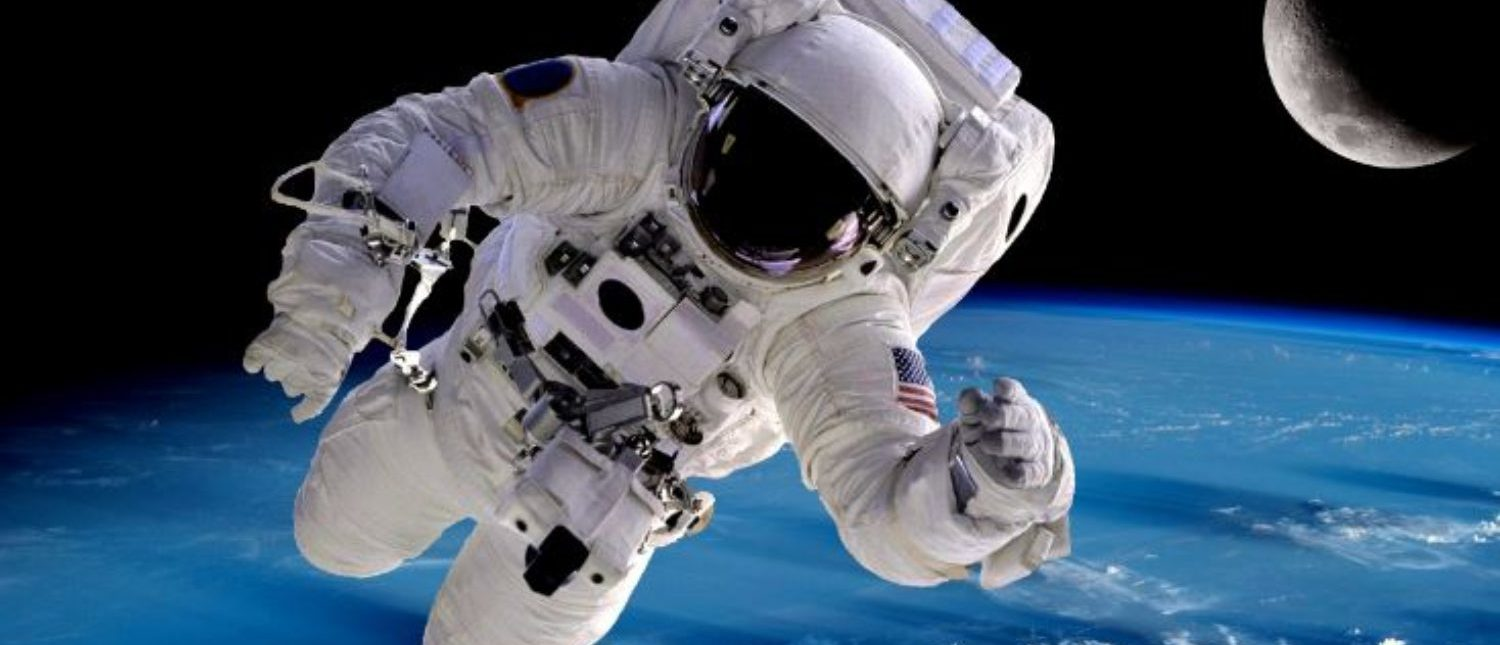 Astronaut spaceman outer space people planet earth moon. Elements of this image furnished by NASA. (Shutterstock/NikoNomad)