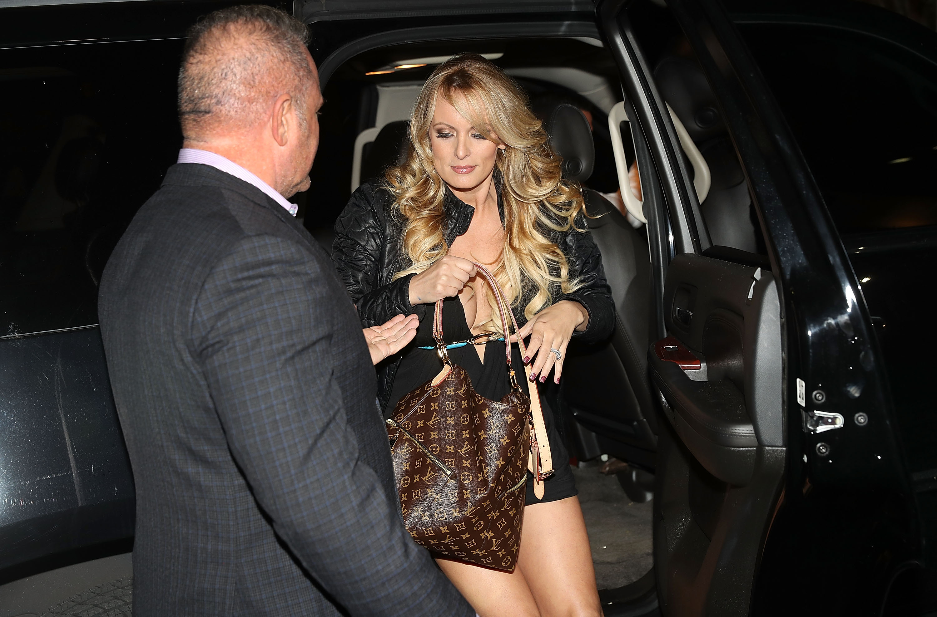 POMPANO BEACH, FL - MARCH 09: The actress Stephanie Clifford, who uses the stage name Stormy Daniels, arrives to perform at the Solid Gold Fort Lauderdale strip club on March 9, 2018 in Pompano Beach, Florida. Stephanie Clifford who claims to have had an affair with President Trump has filed a suit against him in an attempt to nullify a nondisclosure deal with Trump attorney Michael Cohen days before Trump's 2016 presidential victory. (Photo by Joe Raedle/Getty Images)