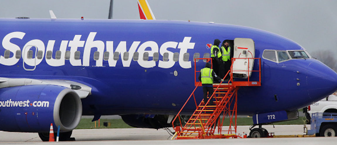 A Southwest Airlines jet sits on the runway at Philadelphia International Airport after it was forced to land with an engine failure, in Philadelphia, Pennsylvania, on April 17, 2018.  A catastrophic engine failure on a Southwest Airlines flight from New York to Dallas killed one person and forced an emergency landing in Philadelphia on Tuesday in a terrifying ordeal for passengers. / AFP PHOTO / DOMINICK REUTER        (Photo credit should read DOMINICK REUTER/AFP/Getty Images)
