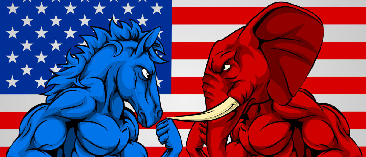 A blue donkey and red elephant fighting in front of an American flag background - ShutterStock - Christos Georghiou