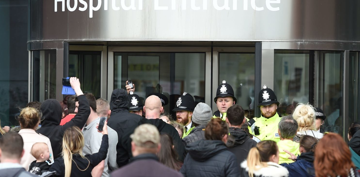Police block the entrance to Alder Hey childrens hospital in Liverpool, northwest England as supporters of British toddler Alfie Evans try to storm the hospital following the announcement that the European court of human rights refused to intervene in his case on April 23, 2018. - Alfie Evans, who is 22 months old, has a rare degenerative neurological condition which has not been definitively diagnosed. His parents, Tom Evans and Kate James, have fought a legal battle to stop the Alder Hey Children's Hospital in Liverpool, northwest England, from turning off his ventilator. (PAUL ELLIS/AFP/Getty Images)