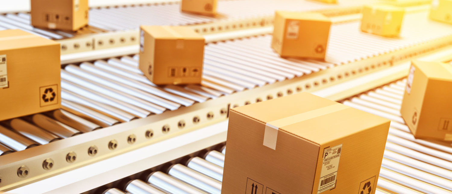 Packages getting ready for delivery at a distribution center. [Shutterstock - cybrain]