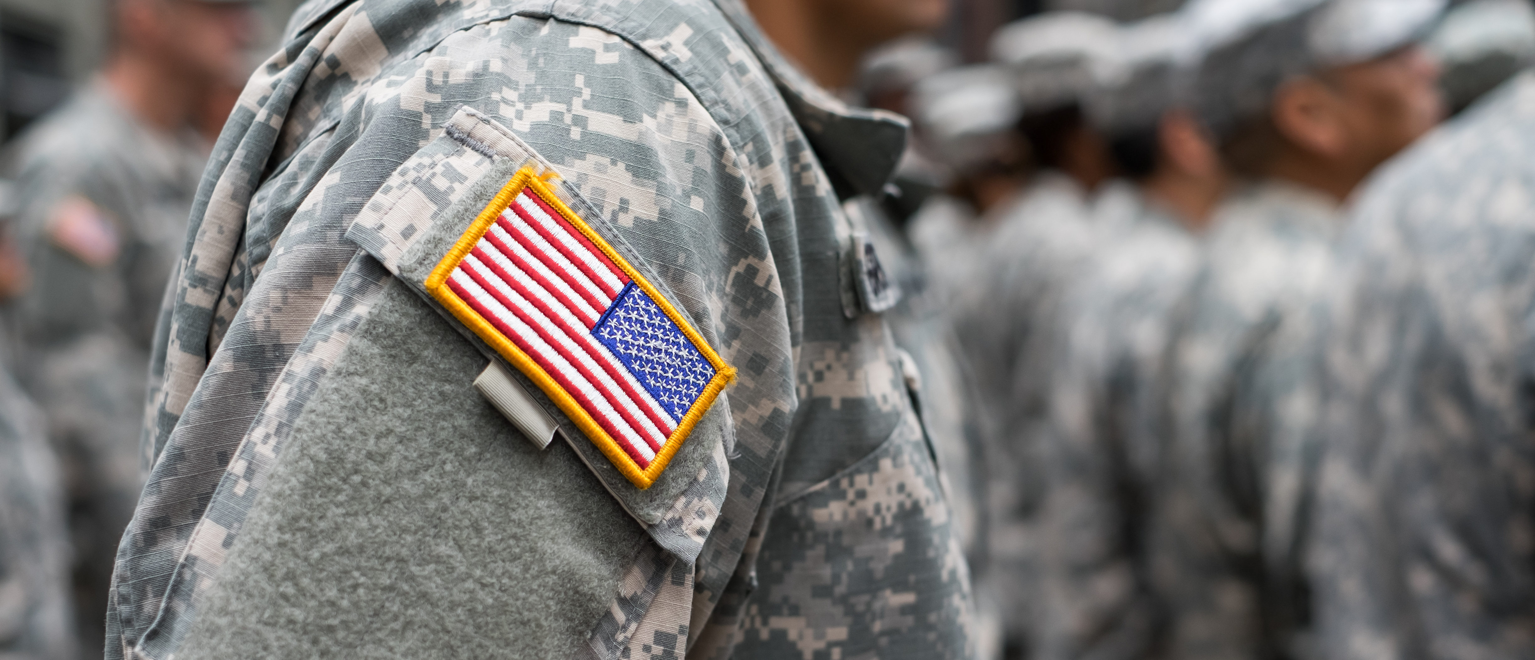 USA patch flag on soldiers arm. Shutterstock