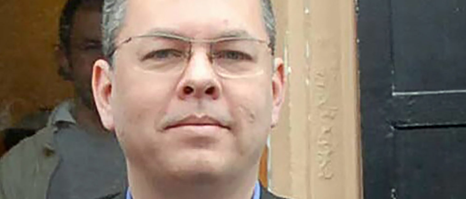 Andrew Brunson, an American pastor held in Turkey for one and a half years in a case that further strained relations between Ankara and Washington, is to go on trial on April 16 on terror-related charges. Brunson, who ran a church in the western city of Izmir, was detained by the Turkish authorities in October 2016 and then remanded in custody. He is charged in the indictment with carrying out activities on behalf of the group led by preacher Fethullah Gulen, who Ankara says masterminded the failed coup in 2016, and the Kurdistan Workers Party (PKK). Both are banned by Turkey as terror groups. / AFP PHOTO / DHA / STR / Turkey OUT (STR/AFP/Getty Images)