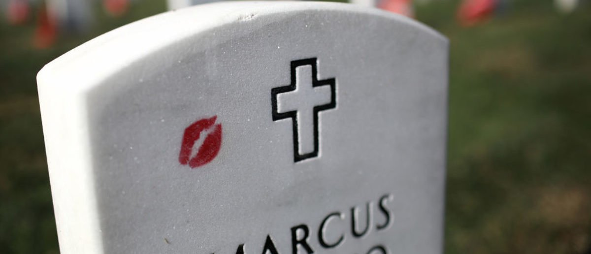 ARLINGTON, VA - NOVEMBER 11: Lipstick marks the headstone of U.S. Army Sgt First Class Marcus Vinicio Muralles at Arlington National Cemetery on Veterans Day November 11, 2017 in Arlington, Virginia. Veterans Day honors all members of the U.S. military who served in the United States Armed Forces. (Photo by Win McNamee/Getty Images)