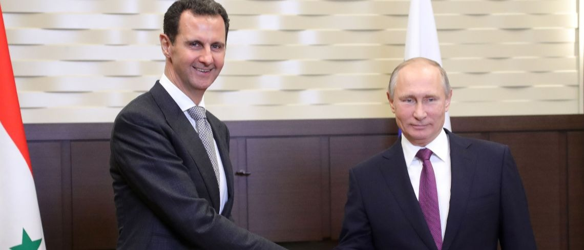 Assad and Putin Getty Images/Mikhail Klimentyev