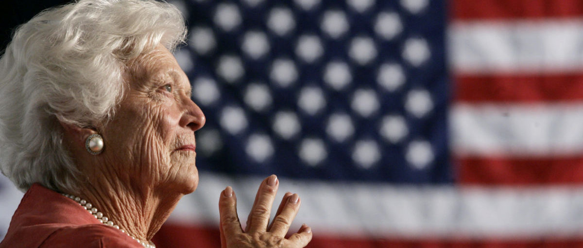 FILE PHOTO: Former U.S. first lady Barbara Bush listens to her son, President George W. Bush, as he speaks at an event on social security reform in Orlando, Florida March 18, 2005. REUTERS/Jason Reed/File Photo