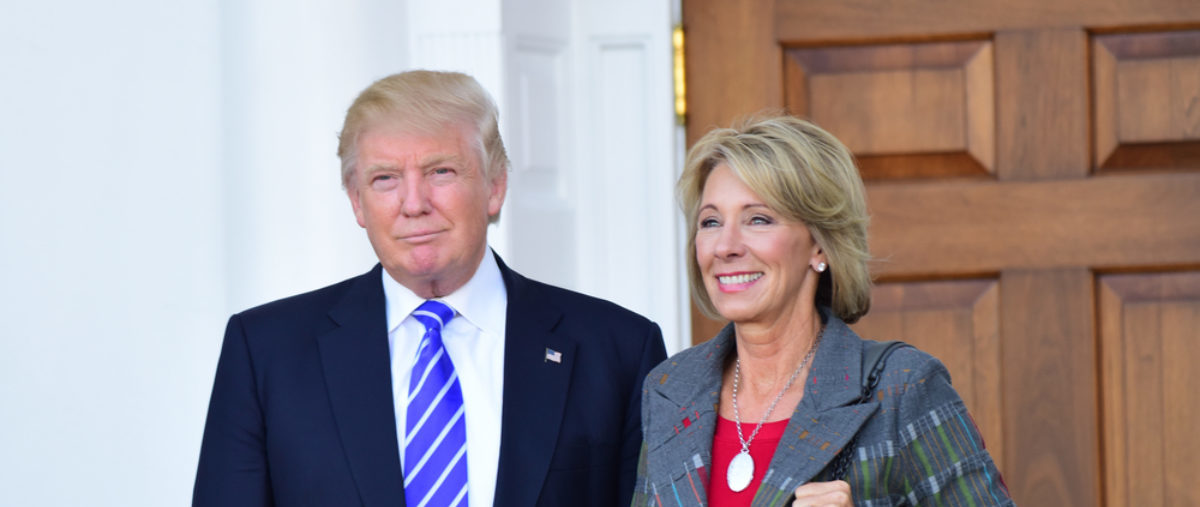 President Donald Trump stands with Education Secretary Betsy DeVos. (Shutterstock/a katz) | Scholar: School Choice A NatSec Concern