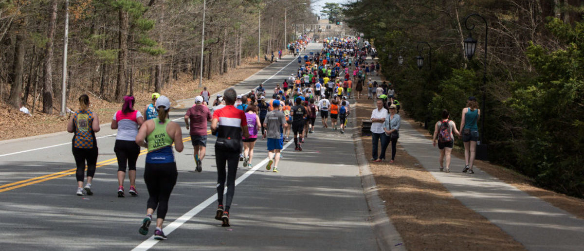 WELLESLEY, MA - APRIL 17: Runners make their way through the half way mark of the marathon in Wellesley, Massachusetts. (Photo by Kayana Szymczak/Getty Images)