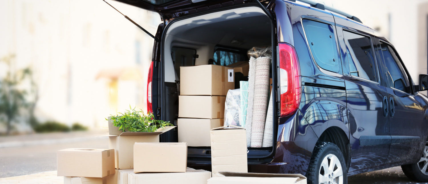 Boxes and packages packed away in a car. [Shutterstock - Africa Studio]   Amazon Wants Key To Your Car For Delivery