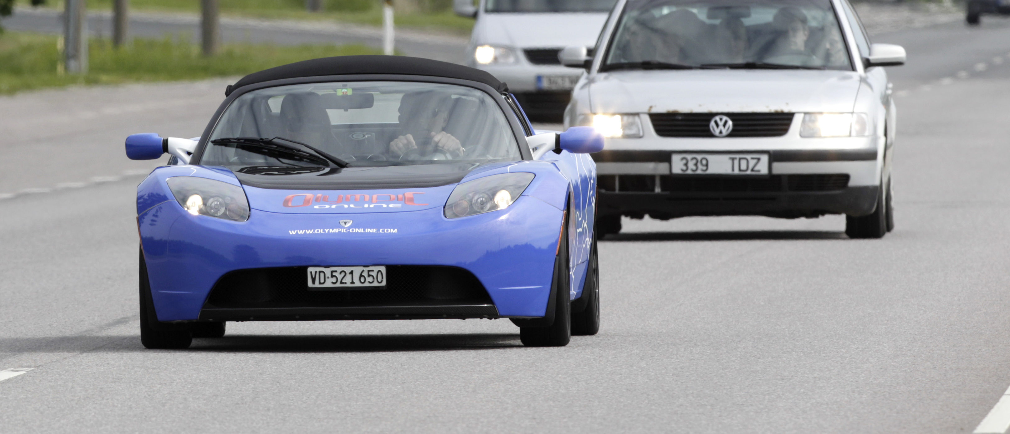 A Tesla Roadster runs on a road during an electric car rally from Tallinn to Monte-Carlo, near Tallinn June 1, 2012. The rally lasts for 10 days, during which electric cars will cross 10 countries and cover a distance of more than 3300 km (2050 miles). According to Tesla, the Roadster has a 302 hp (225 kW) electric engine and can cover more than 390 km (245 miles) per charge. REUTERS/Ints Kalnins