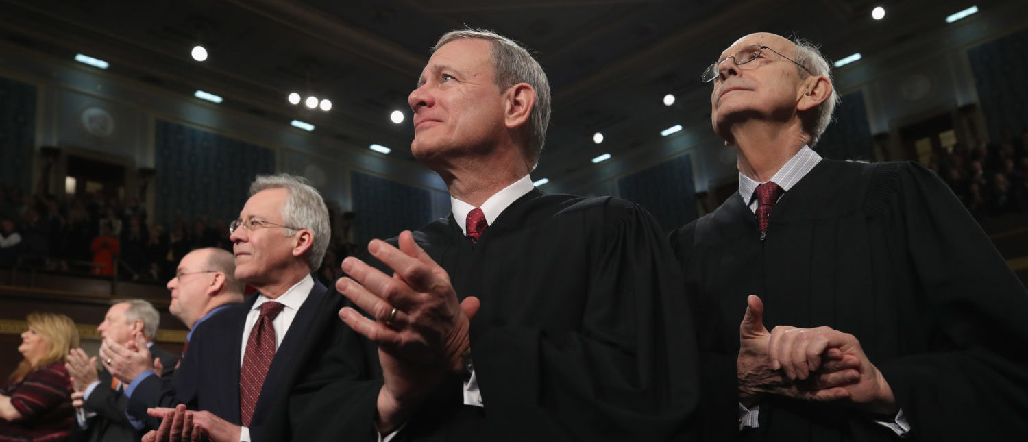 U.S. Supreme Court Chief Justice John G. Roberts and U.S. Supreme Court Associate Justice Stephen G. Breyer attend President Donald Trump's State of the Union address in the chamber of the U.S. House of Representatives in Washington, U.S., January 30, 2018. REUTERS/Win McNamee/Pool