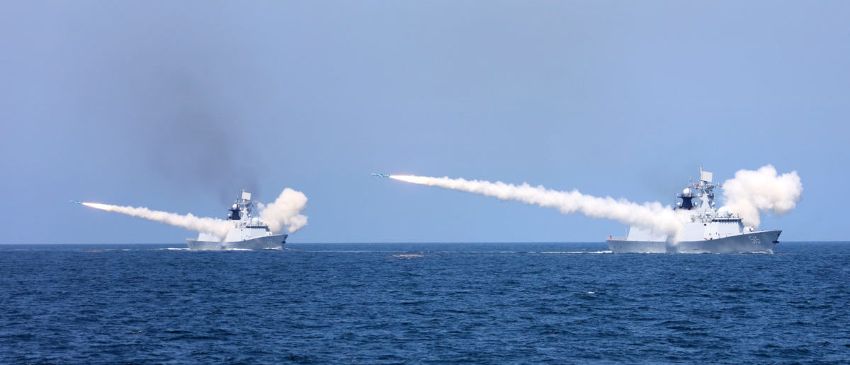 Chinese naval warships fire missiles during a live-fire military drill in the waters of Bohai Sea and Yellow Sea, off China's east coast, August 7, 2017. Picture taken August 7, 2017. REUTERS/Stringer