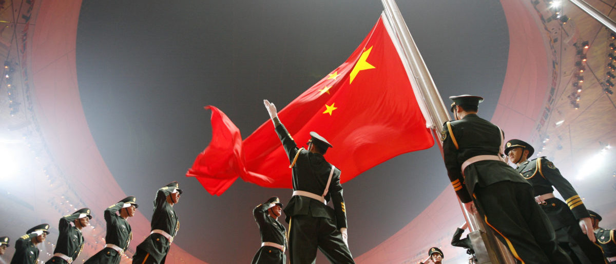 China's national flag is raised during the opening ceremony of the Beijing 2008 Olympic Games at the National Stadium, August 8, 2008. The stadium is also known as the Bird's Nest.     REUTERS/Jerry Lampen