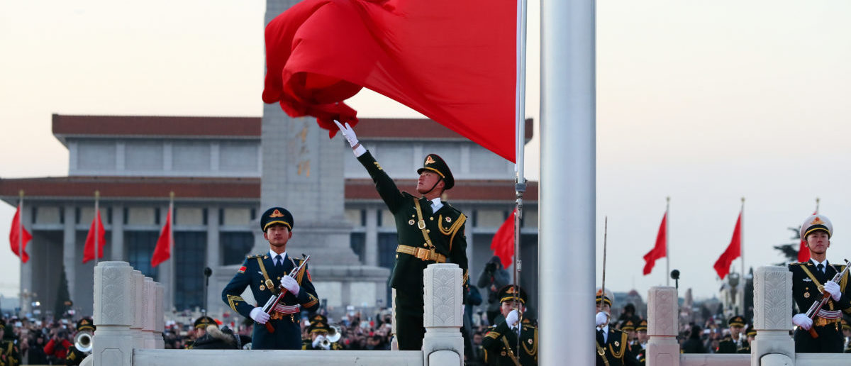 Members of Chinese People's Liberation Army (PLA) take part in the national flag-raising ceremony to mark the New Year, the first since it took over the duty from paramilitary police, on Tiananmen Square in Beijing, China January 1, 2018. REUTERS/Stringer