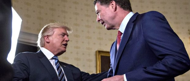 President Donald Trump shakes hands with James Comey, then the director of the FBI, in the Blue Room of the White House in January 2017.Andrew Harrer / Bloomberg via Getty Images | Comey Memo: CNN Prompted Dossier Briefing