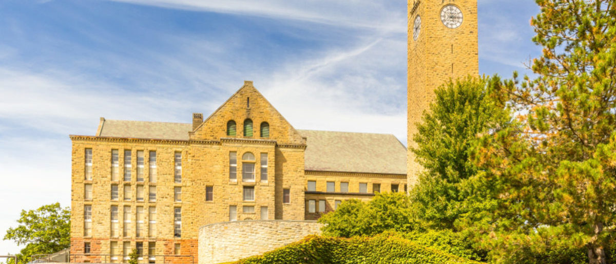 """ITHACA, NY/USA - SEPTEMBER 1, 2017: Featured is the Clock Tower of Cornell University, which recently hosted a free speech/""""hate speech"""" workshop. (Shutterstock/Mihail Degteariov)"""
