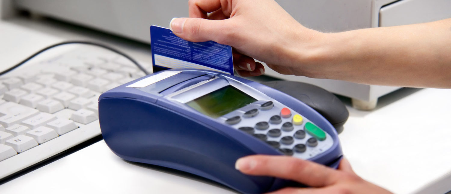 A credit card transaction in process. [Shutterstock - Photobac]