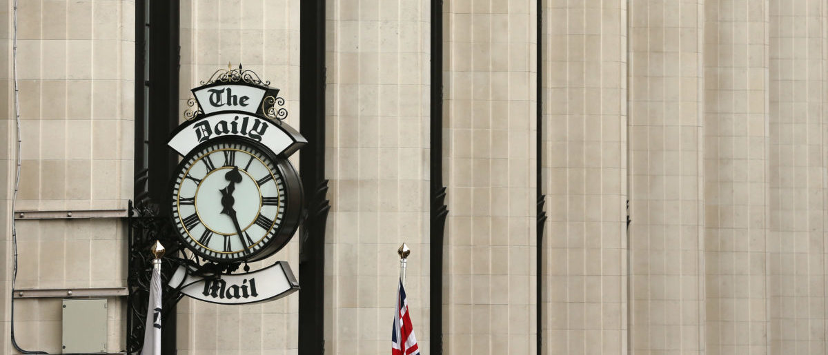 LONDON, ENGLAND - OCTOBER 04: A general view of a clock on the side of Northcliffe House, where the offices of British newspapers the Daily Mail and Mail On Sunday are located, on October 4, 2013 in London, England. The Daily Mail and sister paper The Mail On Sunday are under increasing pressure to apologise after a story published in last week's paper suggested that the leader of the Labour Party Ed Miliband's late father Ralph Miliband was anti-British. Two journalists from the Mail On Sunday were suspended after attending a private family memorial service held for Ed Miliband's uncle uninvited. (Photo by Dan Kitwood/Getty Images)