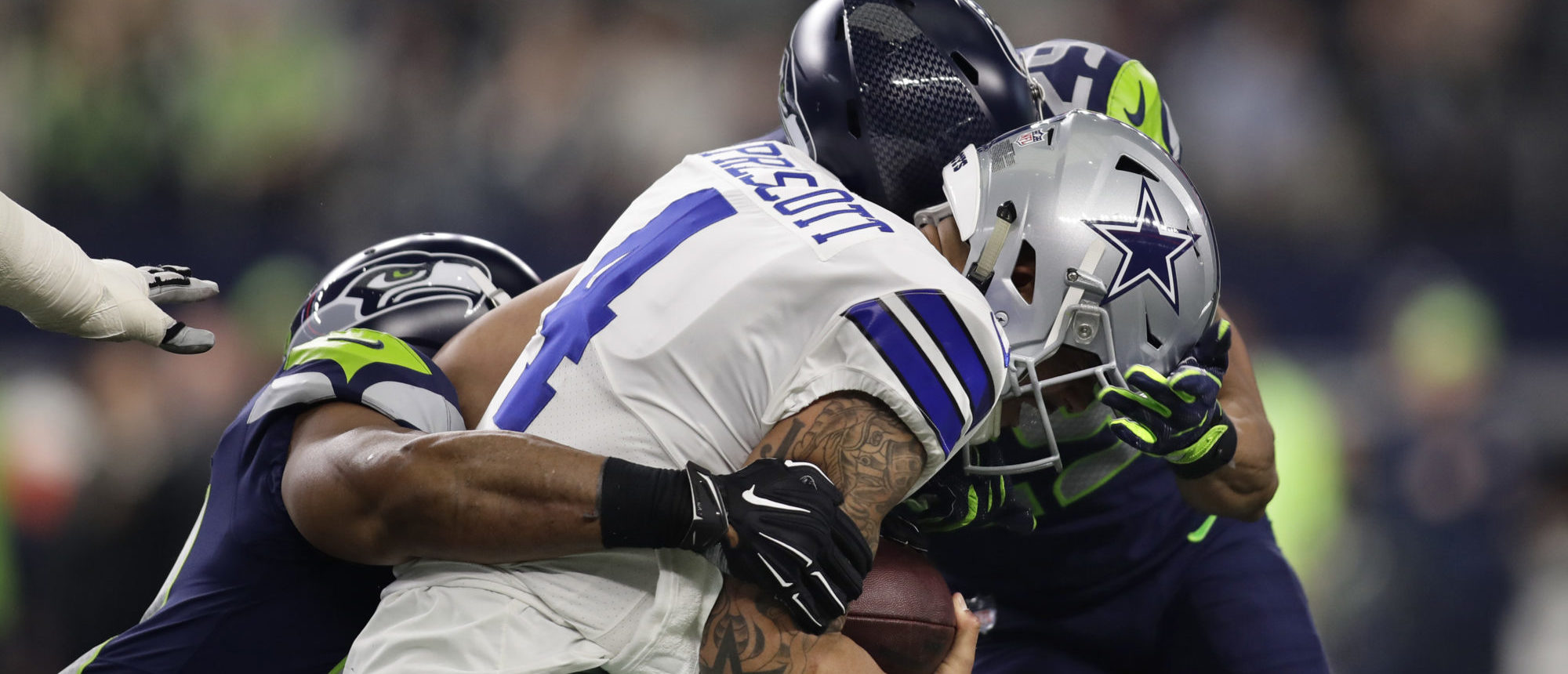 Dallas Cowboys quarterback Dak Prescott (4) is hit in the helmet by the Seattle Seahawks free safety Earl Thomas (29) at AT&T Stadium in Arlington, Texas. Photo: Erich Schlegel-USA TODAY Sports